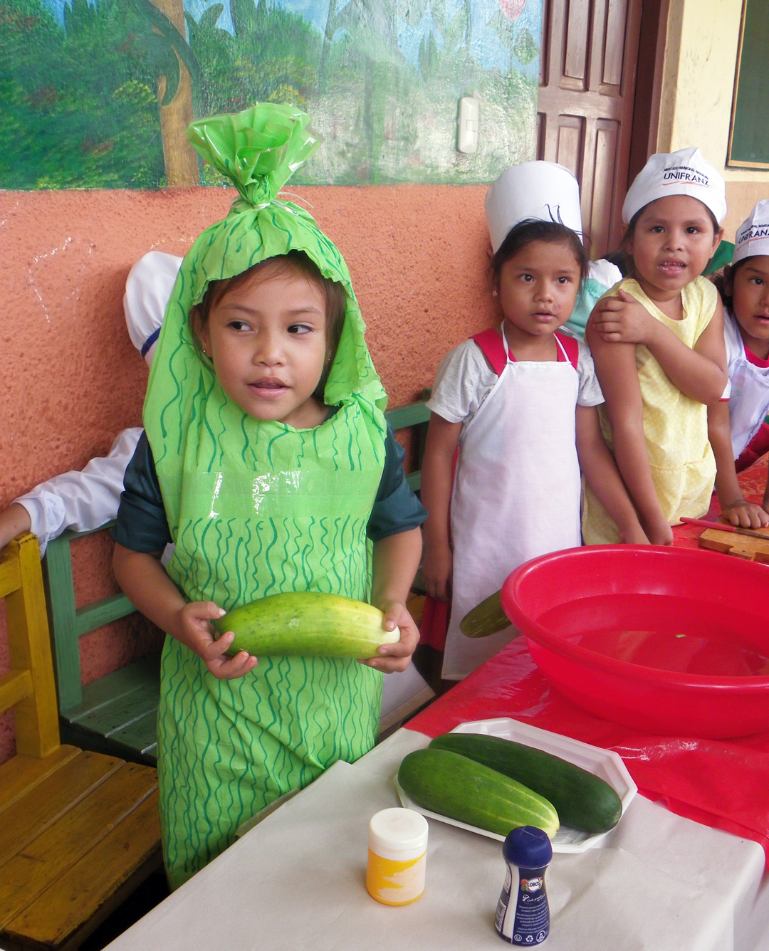 Santa Maria 2: Children at Santa Maria Educational Unit participate in a drama about food. (Photo: Elvira Noe Moye)