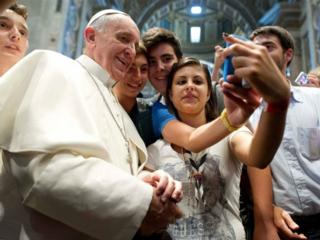 Pope Francis and selfies.